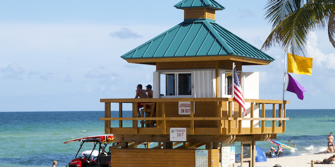 Two Ocean Rescue Lifeguard keep an eye on the ocean and beach-goers on a sunny day.