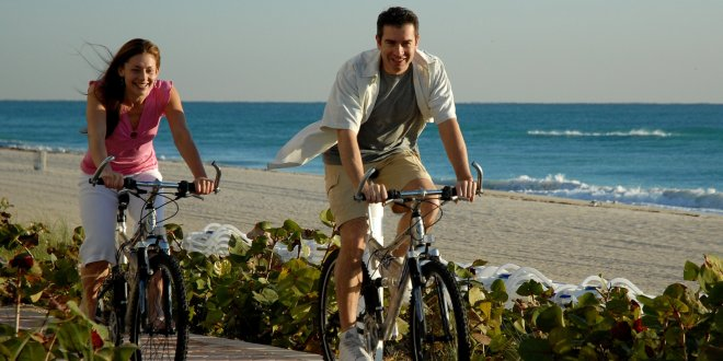 Couple on bikes near the beach