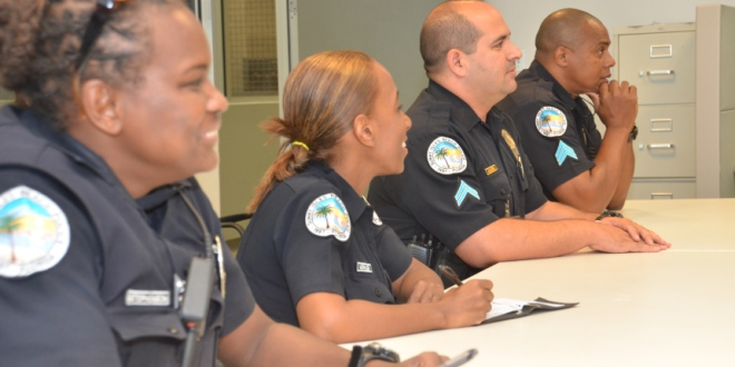 Photo: Police officers at a department meeting