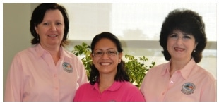 Three Sunny Isles Beach City employees smiling.