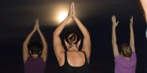 Sunny Isles Beach Yoga Teacher leads a class under the Full Supermoon