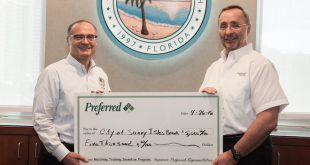 Sunny Isles Beach City Manager Chris Russo is presented an incentive check for working towards a safer environment for our City's pedestrians.