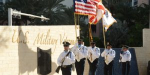Sunny Isles Beach Police Department Carries Flags at Veterans Day Celebration at Heritage Park.