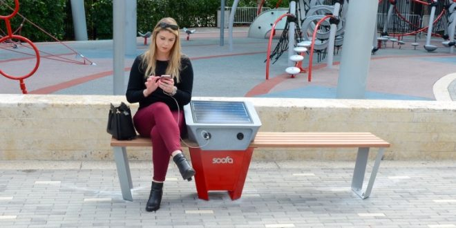 A photo of an SIB Resident using a soofa smart bench.