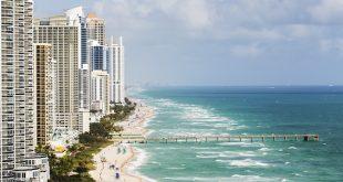 Aerial photo of the Sunny Isles Beach coastline, beach & high-rise buildings.