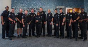 Sunny Isles Beach Police Department Officer stand in a line for a photo.