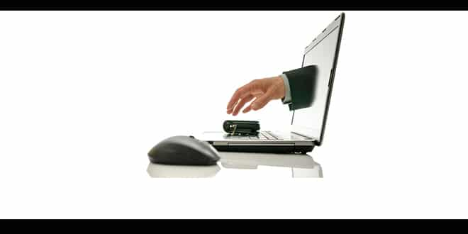 Graphic of a hand reaching out of a computer screen hovering over a wallet depicting identity theft.