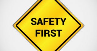 "Image of a yellow diamond sign with the words ""Safety First."""