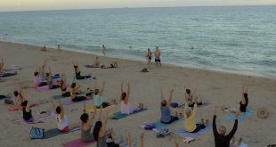 Photo of participants of the August 18 Full Moon Yoga class on the beach.