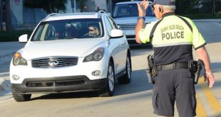 Photo of the Sunny Isles Beach Police directing morning school traffic.