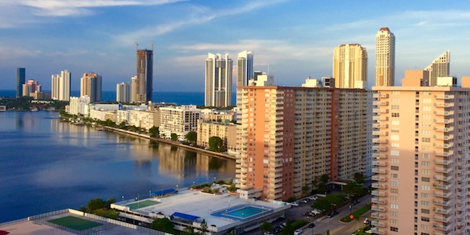 View of Sunny Isles Beach Condominiums and skyline on a clear day with blue skies.