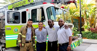 4 Miami Dade Fire Rescue Members Posting in front of their Miami Dade Fire Truck.