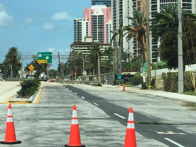 Orange traffic cones block access to northbound Collins Avenue.