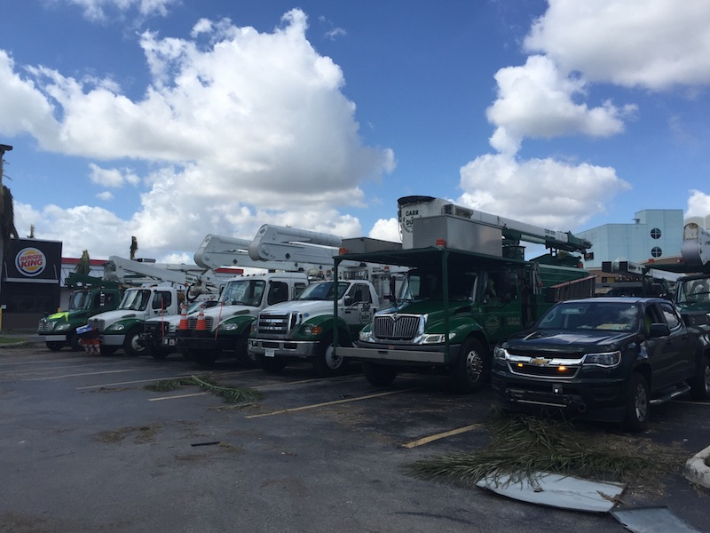 FPL trucks parked lined up at the Burger King Parking lot.