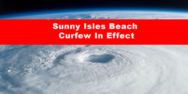"Hurricane imagery on satellite with an overlay of text that reads, ""Sunny Isles Beach Curfew in Effect."""