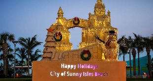 """Holiday Sandcastle that reads, """"Happy Holidays, City of Sunny Isles Beach."""""""