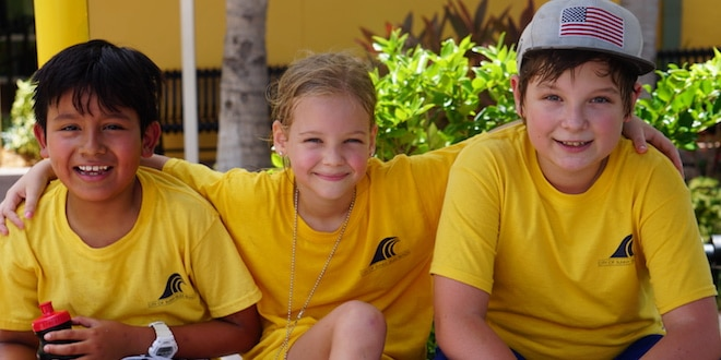 Three children posing for the camera during the End of Summer Camp Picnic.