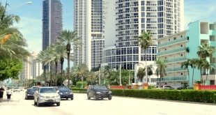 Cars driving on Collins Avenue through Sunny Isles Beach.