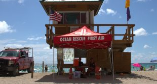 Ocean Rescue lifeguards set up on the beach for Water Safety Month