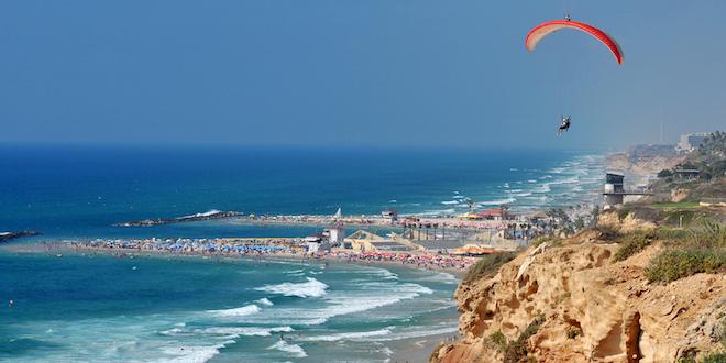 Photo: Para-glider soars over beaches in Netanya Israel