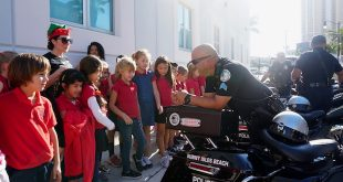 SIB Police Officer talked to students at Career Day.