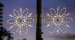 Holiday decoration snowflakes on lightpost