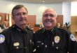 Police Chief Fred Maas and newly sworn-in Police Chief Dwight Snyder.