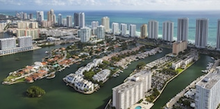 Aerial image of Sunny Isles Beach with view of the Intracoastal and Atlantic Ocean
