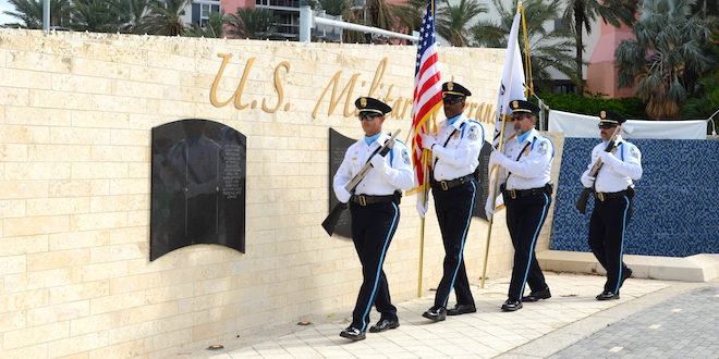 Sunny Isles Beach Color Guard carries flags at Veterans Day Celebration