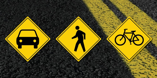 Road with street sign icons for a car, pedestrian and bicycle.