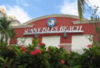 Red building with Sunny Isles Beach seal and lettering