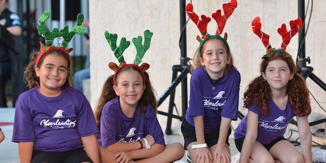 4 girls post with holiday reindeer antler headbands.