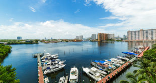Boats docked along the intracoastal with blue sky and water in the background