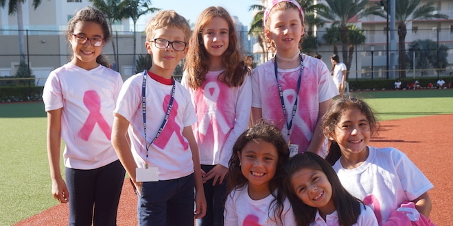 Kids grouped together for picture for Breast Cancer Awareness event