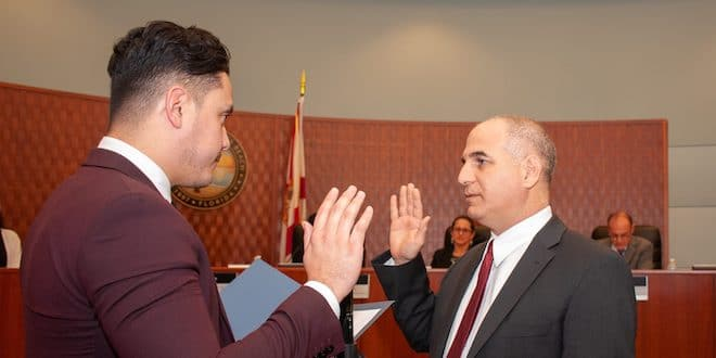 Commissioner Alex Lama is sworn in at Commissioner