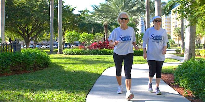 Two women enjoying walking club at Senator Gwen Margolis Park