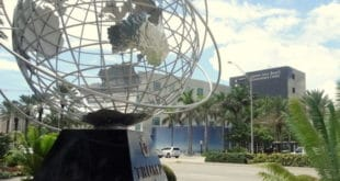 Government Center in background with art installation or world in foreground.