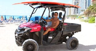 Ocean Rescue lifeguard driving ATV