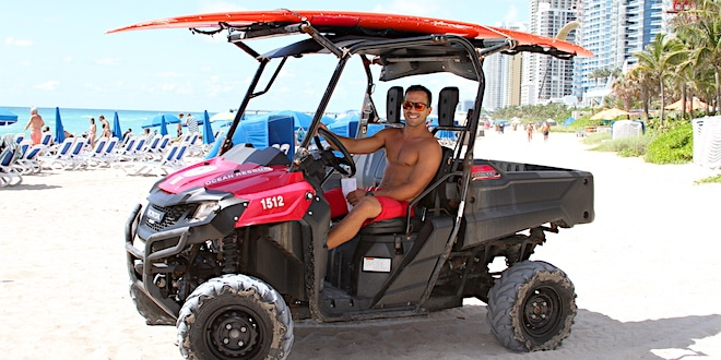 Ocean Rescue lifeguard driving ATV