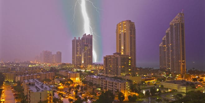 Large lightning strike hits the ocean at night close to Sunny Isles Beach.
