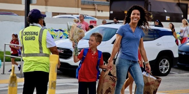 Crossing guard and student with Mom.
