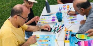 Residents painting in the park.