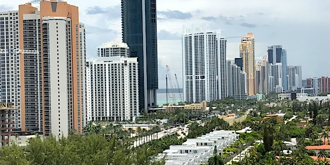 View of Golden Shores neighborhood, Collins Ave and City skyline.