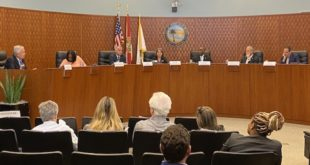 Miami-Dade County Mayoral Candidates answer questions from the dais.