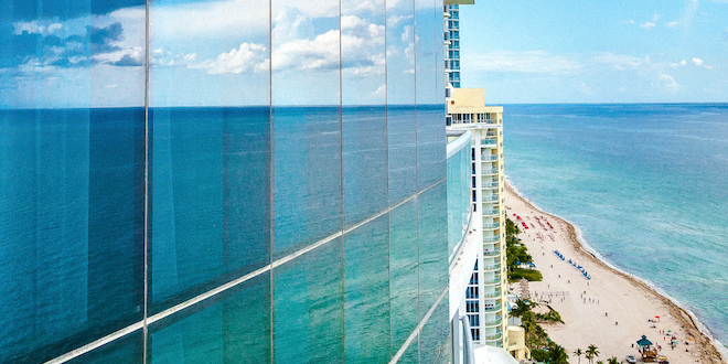 Ocean reflection in high-rise glass panes