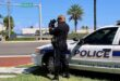 Police officer clocking speeders on Collins Avenue